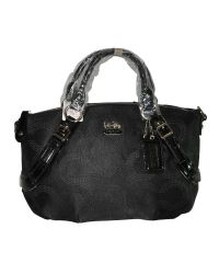 Женская сумка тканевая в круги черная с пряжками